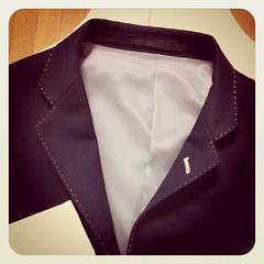 magenta(0.0), dress shirt(0.0), sleeve(0.0), maroon(0.0), tuxedo(0.0), button(0.0), necktie(0.0), pink(0.0), pattern(1.0), textile(1.0), brown(1.0), clothing(1.0), purple(1.0), violet(1.0), collar(1.0), blazer(1.0), outerwear(1.0), formal wear(1.0),