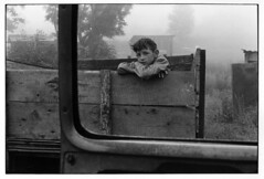 Boy looking out from wooden truck bed, Kentucky, 1971, by William Gedney