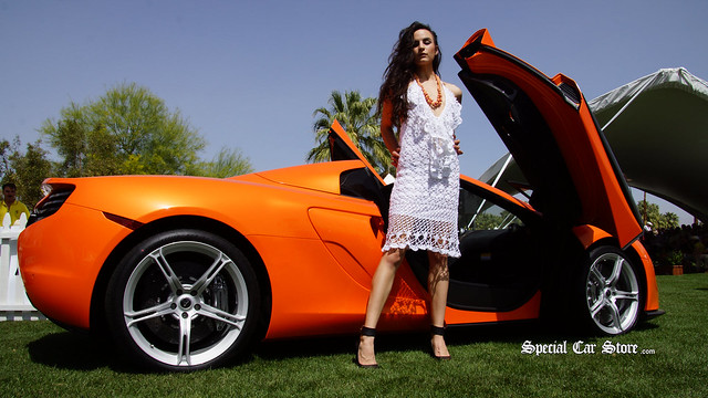 Model wearing knitted dress by She She in front of 2014 McLaren 650S