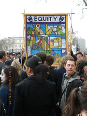 Equity banner being held high