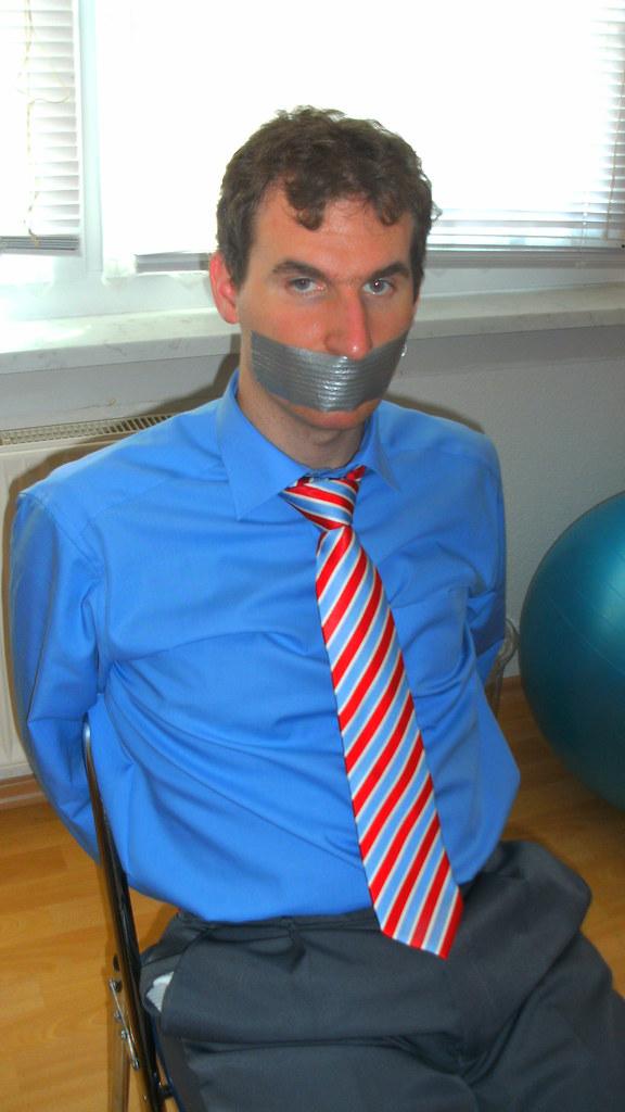 Suit tie bondage