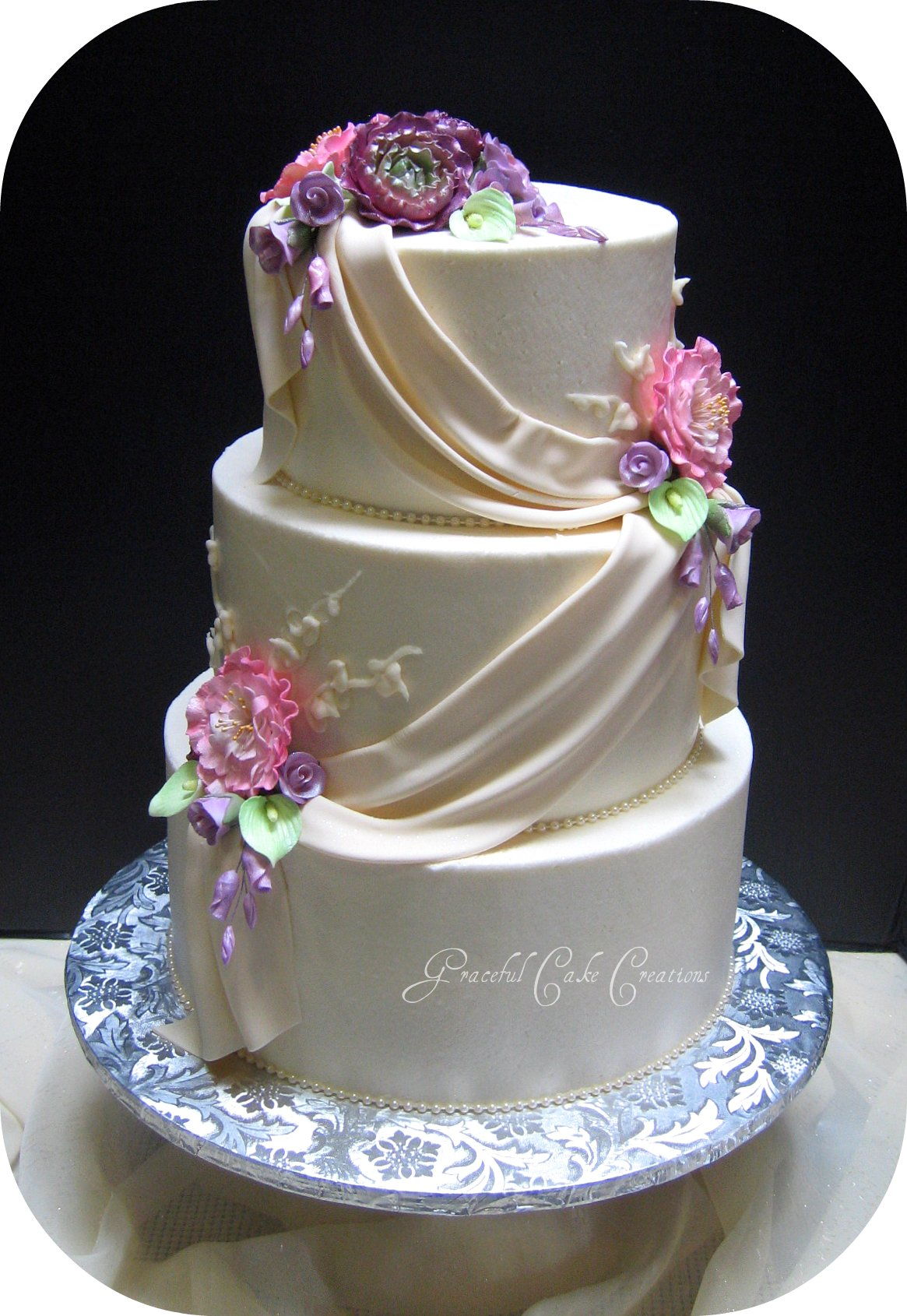 Elegant Ivory Wedding Cake with Fondant Swags | Flickr ...