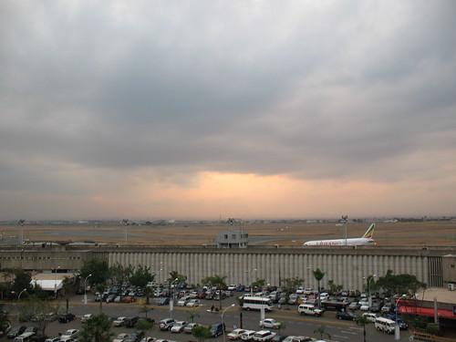 africa sunset sky clouds plane airport parkinglot kenya nairobi overcast international carpark kenyatta runways ethiopianairlines nairobiairport kenyattaairport
