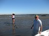Digging for razor clams in the mud by seanaes