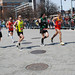 Runners start coming through Kenmore Square in packs as the morning wore on. Photo by Nicole Cousins. BU News Service.