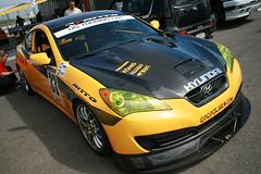 auto show(0.0), auto racing(1.0), automobile(1.0), automotive exterior(1.0), wheel(1.0), vehicle(1.0), automotive design(1.0), hyundai genesis coupe(1.0), bumper(1.0), land vehicle(1.0), luxury vehicle(1.0), coupã©(1.0), supercar(1.0), sports car(1.0),