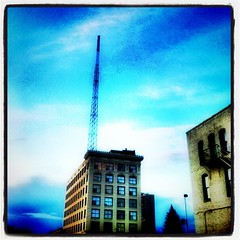 Tall building was always the first to hear the news, due to a radio tower some enterprising human had installed on their roof long ago. As a result, all the other neighborhood buildings would regularly stop by to see what was going on in the world.