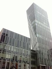 brutalist architecture(0.0), plaza(0.0), tower block(1.0), metropolitan area(1.0), building(1.0), skyscraper(1.0), commercial building(1.0), metropolis(1.0), architecture(1.0), headquarters(1.0), condominium(1.0), facade(1.0), downtown(1.0), tower(1.0),