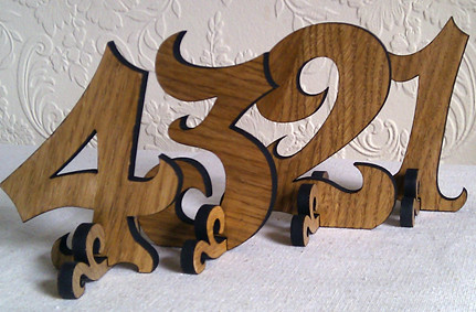 wooden wedding table numbers These wooden table numbers from Hanclock