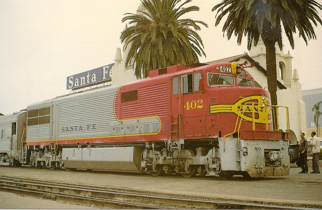 ATSF0007 Santa Fe train No. 74 arrives at San Diego at 10:25 am after a 7:30 Los Angeles departure, covering 128 miles. General Electric 3000 hp U30CG 402 made the trip with seven cars on Sep 13, 1968. U30CG's were renumbered 8000-8005 and are now off the