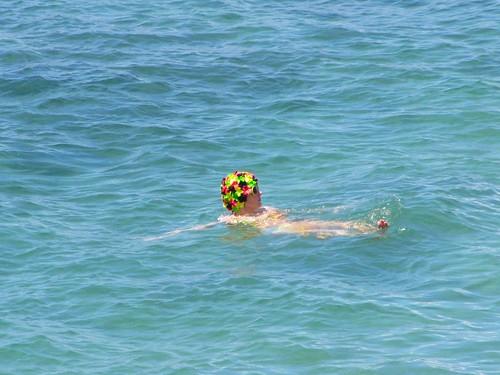 neon flowered bathing cap in the Maui ocean