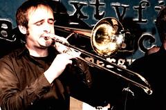 classical music(0.0), bassist(0.0), album cover(0.0), guitarist(0.0), guitar(0.0), drums(0.0), musician(1.0), trumpet(1.0), trombone(1.0), musical instrument(1.0), music(1.0), jazz(1.0), brass instrument(1.0),