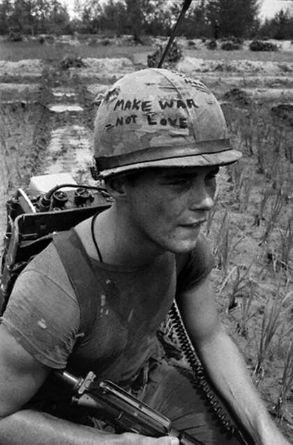 Da Nang, South Vietnam, Marine Cpl. Michael Wynn, 20, of Columbus, Ohio, seems to be trying to get a message across with a takeoff of the hippie slogan