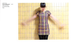 collar(0.0), pattern(0.0), dress(0.0), pattern(1.0), neck(1.0), textile(1.0), clothing(1.0), yellow(1.0), sleeve(1.0), design(1.0), tartan(1.0), plaid(1.0),