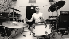 recording(0.0), tom-tom drum(1.0), percussion(1.0), bass drum(1.0), drummer(1.0), musician(1.0), snare drum(1.0), music(1.0), monochrome photography(1.0), drums(1.0), drum(1.0), timbales(1.0), monochrome(1.0), black-and-white(1.0), black(1.0), skin-head percussion instrument(1.0),