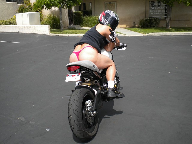 Motorcycle back of thong girls on