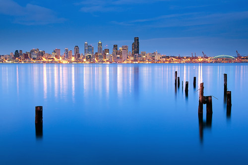seattle city blue sea water skyline buildings reflections lights washington neon skyscrapers hour alki pugetsound pilings bluehour elliottbay