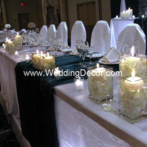 Head table decorations for a wedding reception in hunter green and white