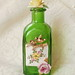 Spring Time and Roses Vintage Jewelry Embellished Bottle