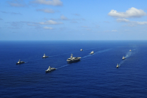 US and Indian Navy ships sail together at the end of training exercise.