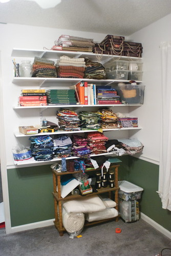 The top two shelves are mostly the fabric samples I've been given. Shelf three contains all books except quilting books. Shelves four and five are all my quilting books and all of my quilting fabric stash.  I still need to decide if I'm going to put two more shelves down below the chair rail.  Most of these items have never had a home before, so seeing them all together and organized is very exciting to me.