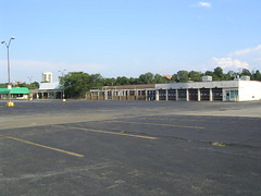 empirestatefuture posted a photo:	Photo: Deadmalls.comThis older strip mall is a common casualty in regions like Greater Rochester, where scads of new development is coming on line at the same time the population of the region remains flat