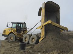 asphalt(0.0), agriculture(0.0), bulldozer(0.0), soil(1.0), sand(1.0), vehicle(1.0), mining(1.0), off-roading(1.0), construction equipment(1.0),