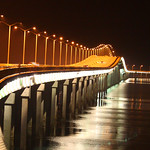 Joggers on the Bay St. Louis bridge at night