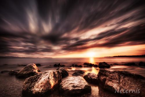 light sunset sea summer sky orange cloud sun lake color reflection water rock stone clouds contrast sunrise landscape waves alone quiet god horizon peaceful calm shore serene chiemsee hdr idyl