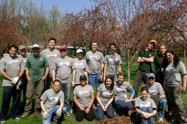 Goldman Sachs Volunteers and Chris Roddick proudly pose with the cherry tree they planted. Photo by Kathryn Littlefield.