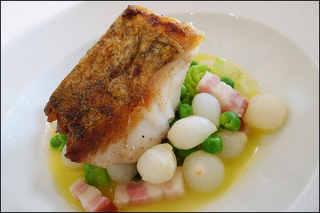 ... Cod , wilted baby gem lettuce , Peas and Pancetta and baby onions