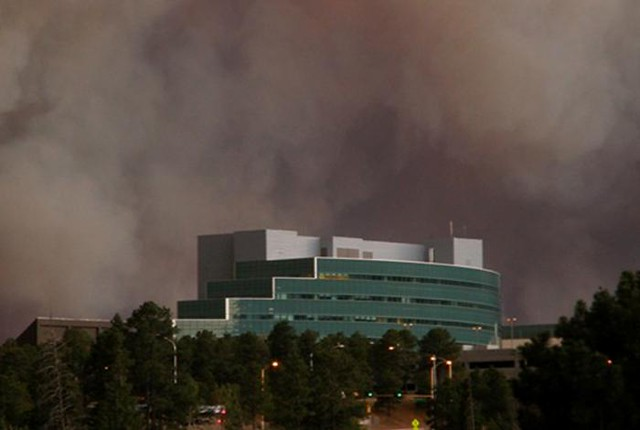 Smoke over the National Security Sciences Building at Los Alamos National Laboratory.