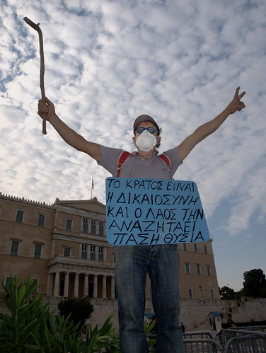 """The state means justice and the people seek it at all costs'- Protesters outside Greek parliament."