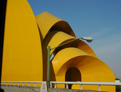 Sun yellow sculpture, metal arches, green street lamp, as seen from the highway, central Guadalajara, Jalisco, Mexico by Wonderlane