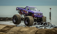 auto racing(0.0), compact sport utility vehicle(0.0), dirt track racing(0.0), automobile(1.0), racing(1.0), wheel(1.0), vehicle(1.0), sports(1.0), off road racing(1.0), motorsport(1.0), off-roading(1.0), rally raid(1.0), monster truck(1.0), off-road vehicle(1.0), bumper(1.0), mud(1.0),
