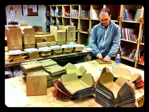 "Unrest 7"" Box Sets being assembled by Mark Robinson by pmonaghan"