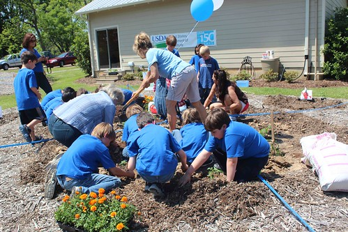 Students from Madison Avenue Elementary plant a People's Garden in Mississippi in honor of the upcoming 150th anniversary of USDA.