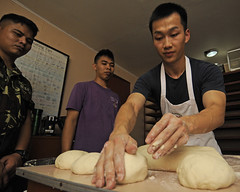 CALBAYOG, Philippines (June 20, 2012) Culinary Specialist 2nd Class Jiefeng Cao demonstrates how to roll dough during a Chef Subject Matter Expert Exchange (SMEE) as part of Pacific Partnership, June 20. (U.S. Navy photo by Mass Communication Specialist 2nd Class Kristopher Regan)