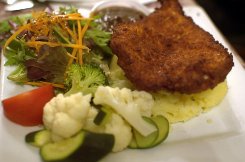 Supreme chicken schnitzel with mash, salad & veggies