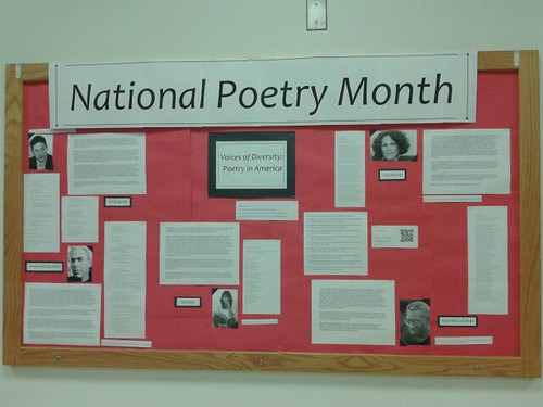 Pictures and readings about poets on a bulletin board