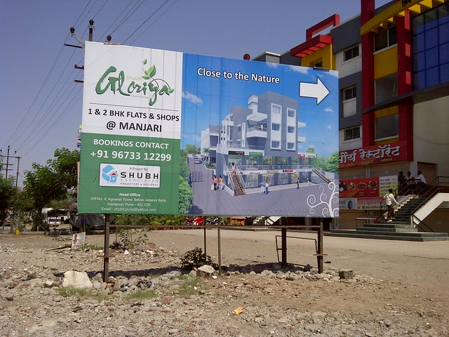 Hoarding of Gloriya - 1 BHK 2 BHK Flats at Manjri - Visit Dreams Avani, 1 BHK & 2 BHK Flats on Shewalwadi Road, near Manjri Stud Farm, off Pune Solapur Highway, at Manjri Budruk Pune, 412 307