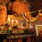 Statue of Lord Buddha in the earth touching mudra, with his two chief students, framed portraits of Sakya Lamas, HE Chogye Trichen Rinpoche, HH Sakya Trizin, offerings, marigolds, murals, throne, Tharlam Monastery of Tibetan Buddhism, Boudha, Nepal