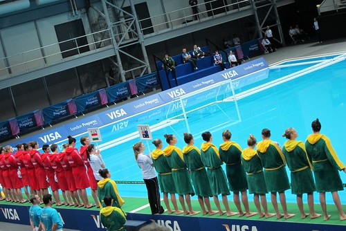 Water polo teams line up in dressing gowns