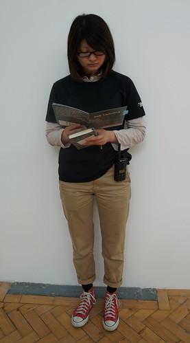 Asako reading a Zoe Leonard catalogue at the Zoe Leonard exhibition (Camden Arts Centre) by Read Me Something You Love