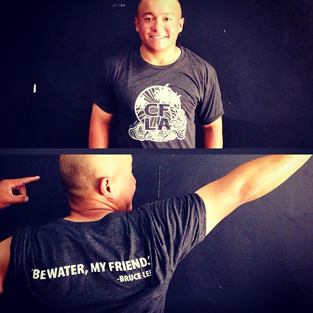 Our man GC modeling our killer new shirt available now in the retail shop. Women's tanks avail, too. #BeWater #BruceLee