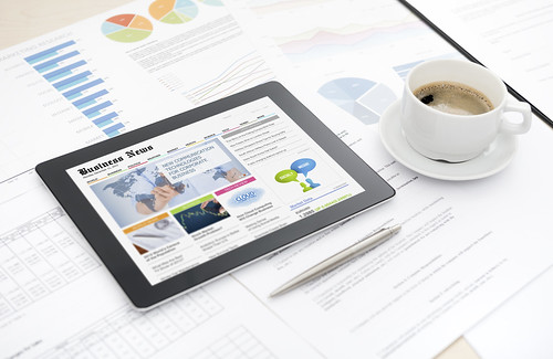 Business news website on electronic tablet