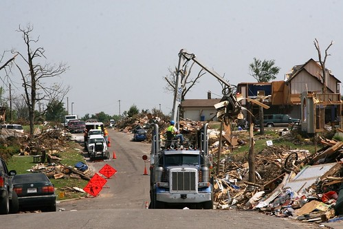 Joplin, Mo., June 7 - Contracted haul trucks work to remove millions of cubic yards of debris [Image 2 of 5]