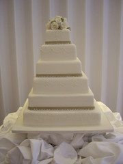 A hand-piped 6 tier wedding cake at Coworth Park, Ascot last month. Adorned with diamantes of course!
