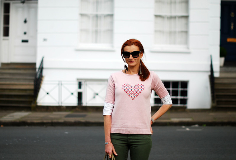 Pink motif sweater & olive skinnies