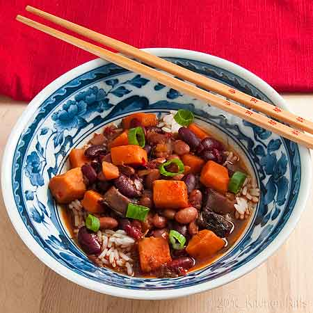 Red-Braised Beans and Sweet Potatoes in Chinese Rice Bowl with Chop Sticks